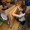Caleb, 6, and Natalie Warpula, 2, decroate their cardboard cars during the drive-in movie night at Leominster City Hall on Thursday, February 23, 2017. Children were able to come in and design their own box car and enjoy pizza and snacks while watching 'Zootopia' on a large projector screen. SENTINEL & ENTERPRISE / Ashley Green