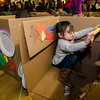 Natalie Warpula, 2, focuses intently on decorating her cardboard car during the drive-in movie night at Leominster City Hall on Thursday, February 23, 2017. Children were able to come in and design their own box car and enjoy pizza and snacks while watching 'Zootopia' on a large projector screen. SENTINEL & ENTERPRISE / Ashley Green