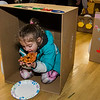 Grace Monahan, 4, enjoys a slice of pizza in her cardboard car during the drive-in movie night at Leominster City Hall on Thursday, February 23, 2017. Children were able to come in and design their own box car and enjoy pizza and snacks while watching 'Zootopia' on a large projector screen. SENTINEL & ENTERPRISE / Ashley Green