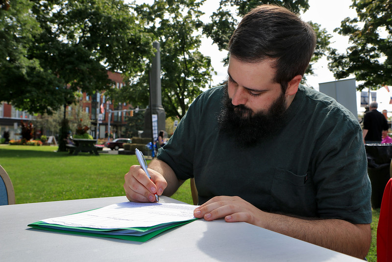 Leominster's Mayor's Office with North Central Career Centers of Leominster held a job fair on Tuesday morning on Monument Square in the city. Nicholas Kopaz, 28, of West Townsend fills out a job application during the fair. He has been looking for work for a while. SENTINEL & ENTERPISE/JOHN LOVE