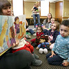 There were many children and their parents at Thursday, February 2, 2017  story hour at the Leominster Public Library. Enjoying the book that Children's Library Associate Amy Shea was reading to the kids is Isaiah Kamawu, 2, of Leominster with many of the other children. SENTINEL & ENTERPRISE/JOHN LOVE