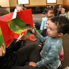 There were many children and their parents at Thursday, February 2, 2017  story hour at the Leominster Public Library. Enjoying the book that Children's Library Associate Amy Shea was reading to the kids is Isaiah Kamawu, 2, with many of the other children. SENTINEL & ENTERPRISE/JOHN LOVE