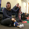 There were many children and their parents at Thursday, February 2, 2017  story hour at the Leominster Public Library. Leading the story hour is Children's Library Associate Amy Shea. SENTINEL & ENTERPRISE/JOHN LOVE