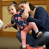 There were many children and their parents at Thursday, February 2, 2017  story hour at the Leominster Public Library. Participating in story hour is Jessicia Proietti and her daughter Claire Proietti, 14 months, from Leominster. SENTINEL & ENTERPRISE/JOHN LOVE