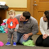 There were many children and their parents at Thursday, February 2, 2017  story hour at the Leominster Public Library. Julia Henrie, 15 months, thinks about joining in on the story ohour but was not sure. With him is his dad and mom Jon and Meghan Henrie. SENTINEL & ENTERPRISE/JOHN LOVE