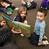 There were many children and their parents at Thursday, February 2, 2017  story hour at the Leominster Public Library. Enjoying the book that Children's Library Associate Amy Shea was reading to the kids is Bella Chitu , 2, of Fitchburg and Isaiah Kamawu, 2,  of Leominster with many of the other children. SENTINEL & ENTERPRISE/JOHN LOVE