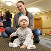 There were many children and their parents at Thursday, February 2, 2017  story hour at the Leominster Public Library. Enjoying herself at the story hour is Cora Aspenson, 5 months, and her mom Ali Aspenson from Shirley. SENTINEL & ENTERPRISE/JOHN LOVE