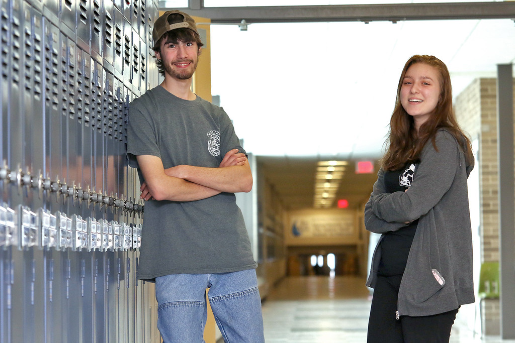 . Leominster High School students Cynthia Ablert, 16, and Nick Penniman, 17, are making and selling t-shirts to help out veterans. SENTINEL & ENTERPRISE/JOHN LOVE