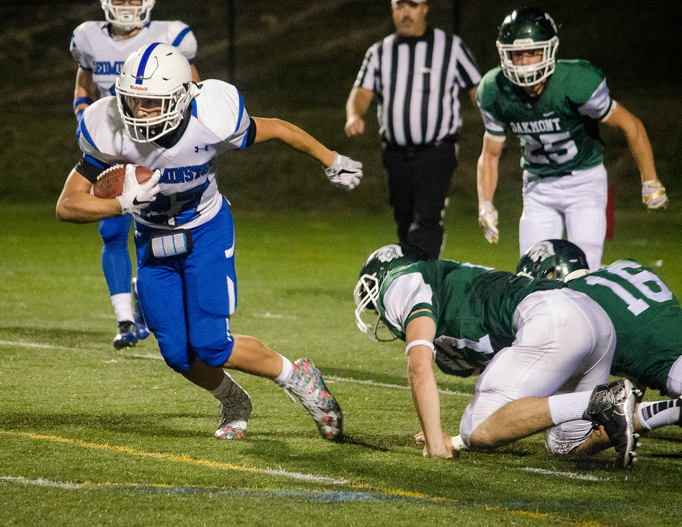 . Leominster\'s Adam Couch evades the Oakmont defense on Friday evening. SENTINEL & ENTERPRISE / Ashley Green