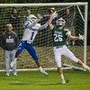 Oakmont's Jarrod Erskine breaks up a pass to Leominster's Allen Link on Friday evening. SENTINEL & ENTERPRISE / Ashley Green