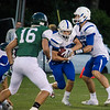 Leominster quarterback Noah Gray hands off to Adam Couch during the game against Oakmont on Friday evening. SENTINEL & ENTERPRISE / Ashley Green