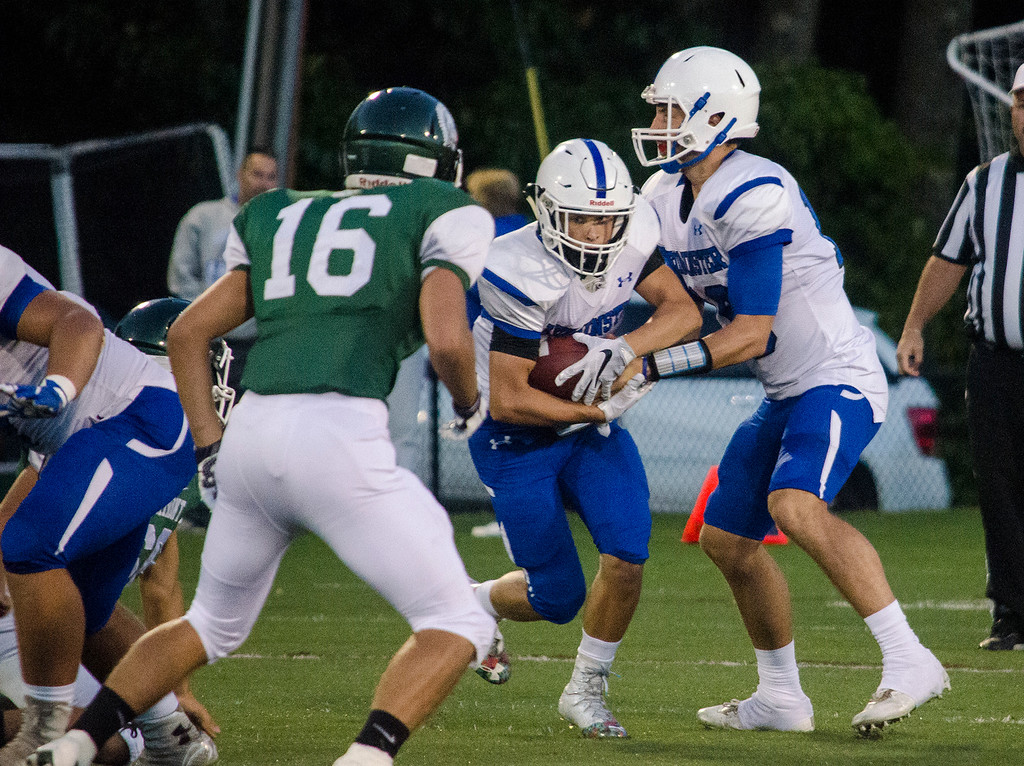. Leominster quarterback Noah Gray hands off to Adam Couch during the game against Oakmont on Friday evening. SENTINEL & ENTERPRISE / Ashley Green