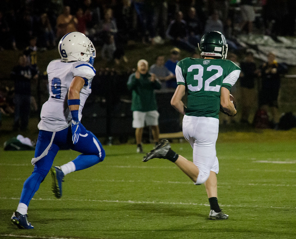 . Oakmont\'s Anthony Dalbon evades the Leominster defense to run it in down a 98-yard touchdown on Friday evening. SENTINEL & ENTERPRISE / Ashley Green