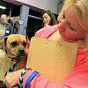A vaccinations and microchipping for your pet was held at the Leominster Emergency Management building on Saturday, September 29, 2018. Holly Macauley from Leominster holds her puggle Brandy, 3, as they wait in line for their turn to get a microchip. SENTINEL & ENTERPRISE/JOHN LOVE