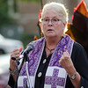 Rev. Susan Suchocki Brow, of the First Church Unitarian Universalist Church, leads a prayer during the vigil in memory of Leominster-born Vanessa Marcotte. Worcester County District Attorney Joseph Early Jr. confirmed during a press conference on Monday that the body of missing jogger and former Leominster resident Marcotte, 27, had been found in Princeton and that her death is being investigated as a homicide. SENTINEL & ENTERPRISE / Ashley Green