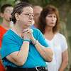 Cindy Trainque folds her hands in prayer during the vigil in memory of Leominster-born Vanessa Marcotte. Worcester County District Attorney Joseph Early Jr. confirmed during a press conference on Monday that the body of missing jogger and former Leominster resident Marcotte, 27, had been found in Princeton and that her death is being investigated as a homicide. SENTINEL & ENTERPRISE / Ashley Green
