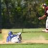 Leominster basebrunner James Powers slides safe into 2nd during Monday's varsity baseball game at home ahainst Algonquin.  SENTINEL & ENTERPRISE JEFF PORTER