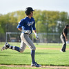 Leominster baserunner Rocco Pandiscio sprints down the first base line for a single during Monday's varsity baseball game at home against Algonquin.  SENTINEL & ENTERPRISE JEFF PORTER