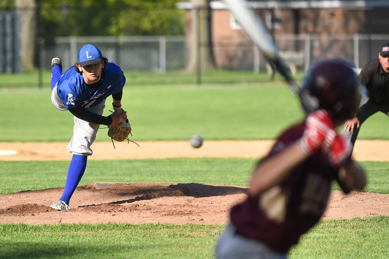Leominster pitcher Lowell Pare opens up Monday's varsity baseball game at home against Algonquin.  SENTINEL & ENTERPRISE JEFF PORTER