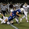 3 players on Anthony Dandini as he rushes