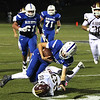 Leom QB Patrick Gallagher is hit by Zach Smith