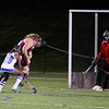 Leom Isabella Dias moves towards the net with Anna Jordan on defense and goalie Brooke Feltus