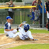 Leom Tony Salvatelli slides into home after a bad pitch and is and is safe with the 1st run of the game