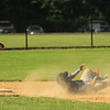 LHS Rocco Pandiscio goes down after getting hit by the ball as he ran to 2nd base SENTINEL&ENTERPRISE/Scott LaPrade