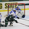 Nashoba's Ryan LeBlanc gets a side shot in front of Leom's Matt Kendall and goalie Camneraon Isabelle<br /> SENTINEL&ENTERPRISE/Scott LaPrade