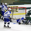 Nashoba's Roberty Gibbons attempts to stuff the puck with Leom's Anthony Tocci helping his goalie Cameron Isabelle SENTINEL&ENTERPRISE/Scott LaPrade