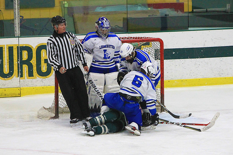 Pile up in front of Goalie Cameron Isabelle with a Nashoba player on the bottom <br /> SENTINEL&ENTERPRISE/Scott LaPrade