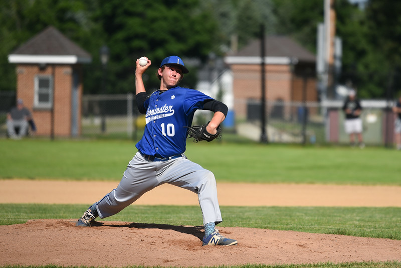 Leominster pitcher Patrick Gallagher winds up for the pitch during Monday's tournament game at Doyle Field in Leominster against Shrewsbury.  SENTINEL & ENTERPRISE JEFF PORTER