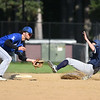 Lowell Pare of Leominster (left)  attempts to tag out Shrewsbury base runner Colby Meyer during Monday's tournament game at Doyle Field in Leominster.  SENTINEL & ENTERPRISE JEFF PORTER