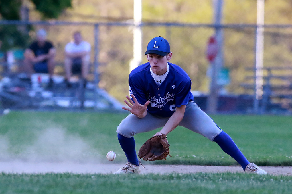 . Leominster High School played St. Peter-Marian at the Central Mass. Division 1 championship held at Tivnan Field at Lake Park on Saturday night. LHS shortstop Matt Dupuis gets ready to get a ground ball during action in the game. SENTINEL & ENTERPRISE/JOHN LOVE