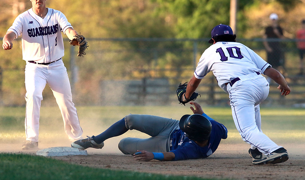 . Leominster High School played St. Peter-Marian at the Central Mass. Division 1 championship held at Tivnan Field at Lake Park on Saturday night. LHS\'s Rocco Pandiscio slides save into second before Jeff Lamothe could tag him during action in the game. SENTINEL & ENTERPRISE/JOHN LOVE