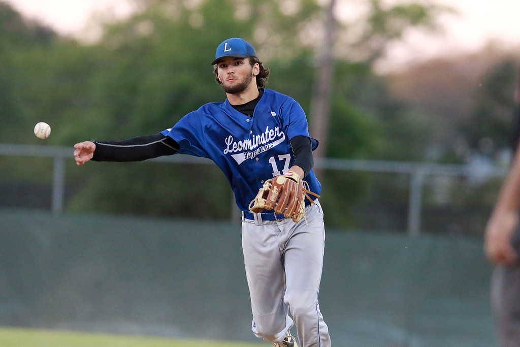 . Leominster High School played St. Peter-Marian at the Central Mass. Division 1 championship held at Tivnan Field at Lake Park on Saturday night. LHS playewr Lowell Pare throws to first for an out after picking up a ground ball during action in the game. SENTINEL & ENTERPRISE/JOHN LOVE