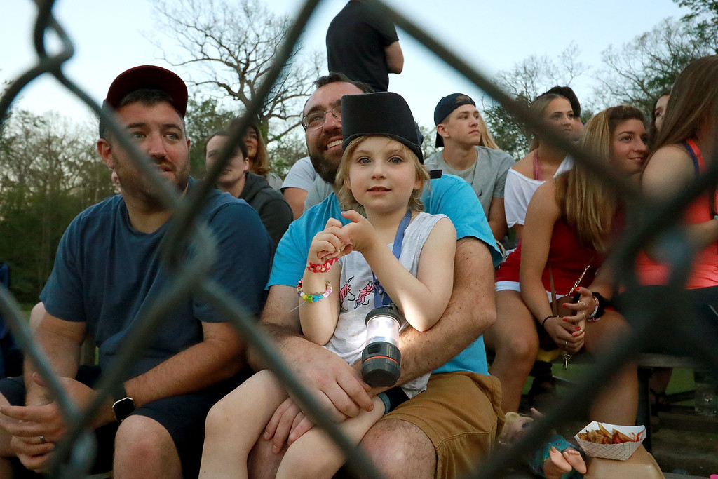 . Leominster High School played St. Peter-Marian at the Central Mass. Division 1 championship held at Tivnan Field at Lake Park on Saturday night. Gabby Thomas, 5, had on her rally cap as she watched the end of the game on her dad Greg Thomas\' lap at the game. SENTINEL & ENTERPRISE/JOHN LOVE