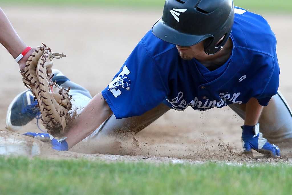 . Leominster High School played St. Peter-Marian at the Central Mass. Division 1 championship held at Tivnan Field at Lake Park on Saturday night. LHS player Mason Nickoloff dives back to first before being tagged during action in the game. SENTINEL & ENTERPRISE/JOHN LOVE