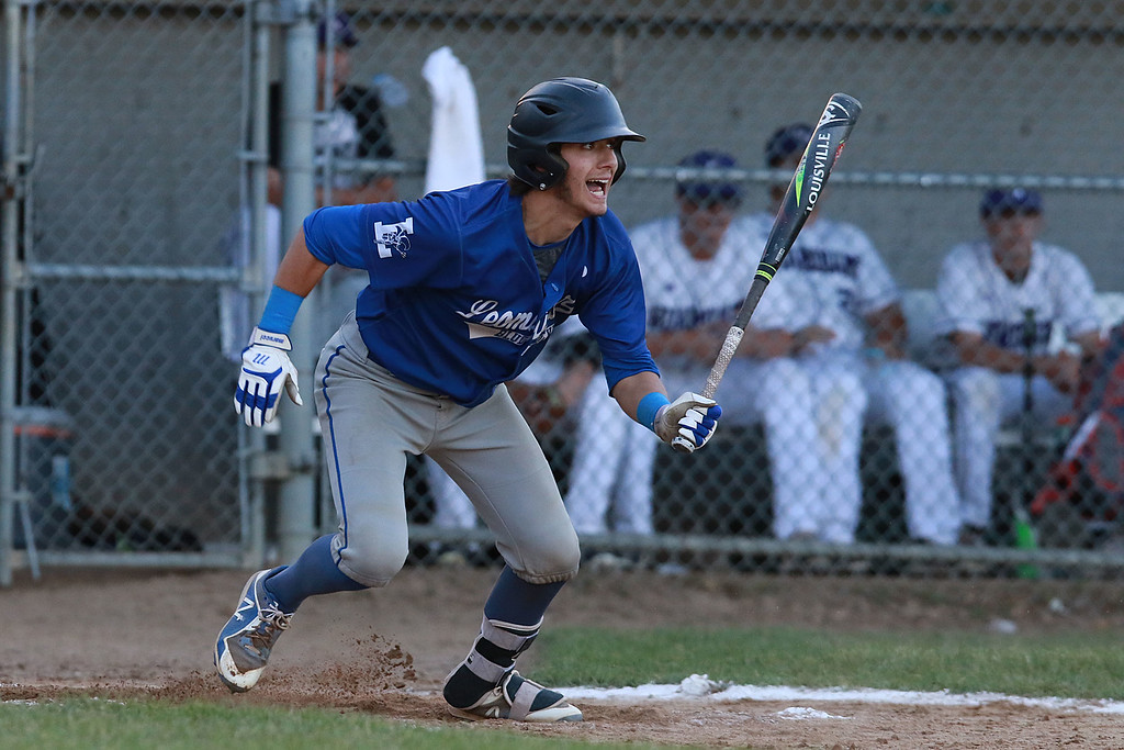 . Leominster High School played St. Peter-Marian at the Central Mass. Division 1 championship held at Tivnan Field at Lake Park on Saturday night. LHS Rocco Pandiscio reacts to his hit as he gets ready to run down the first baseline during action in the game. SENTINEL & ENTERPRISE/JOHN LOVE