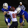 Anthony Dandini rushes with the ball Thomas Mespelli on the tackle