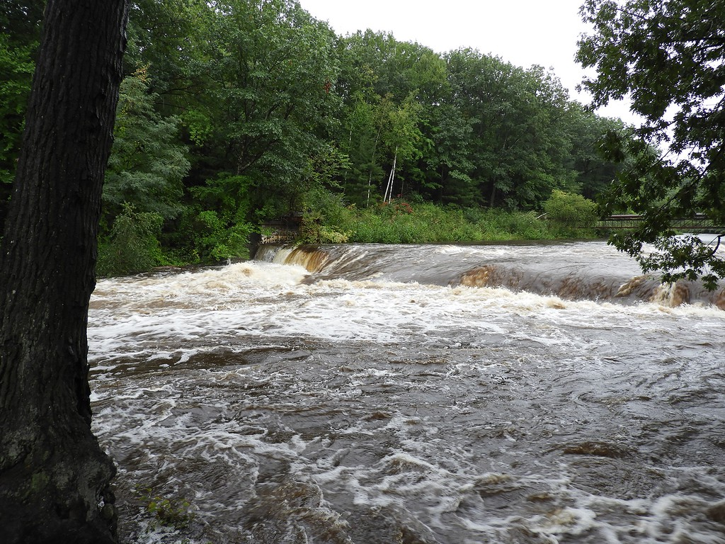 . The Nashua River was roaring through FItchburg Tuesday morning during the heavy rains. SENTINEL & ENTERPRISE / CLIFF CLARK