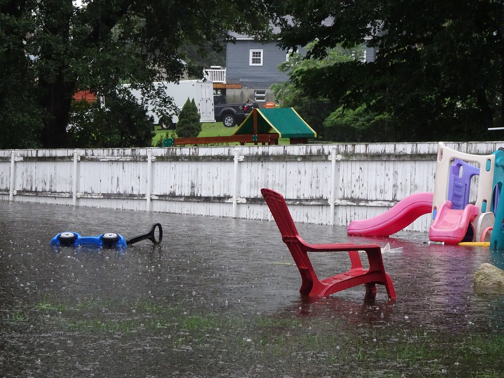 . The flooded backyard of 33 Burrage Avenue in Leominster, where rainfall pooled during Tuesday\'s storm. SENTINEL & ENTERPISE / PETER JASINSKI