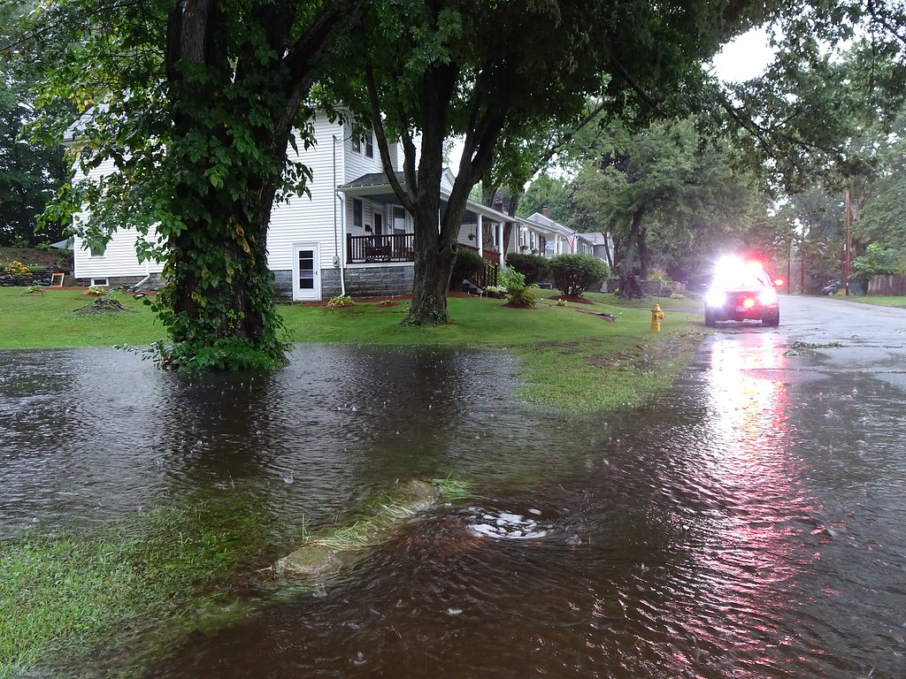 . Some of the flooding that swept across yards and roads at the intersection of Burrage Avenue and Mascoma Street in Leominster on Tuesday.  SENTINEL & ENTERPRISE / PETER JASINSKI