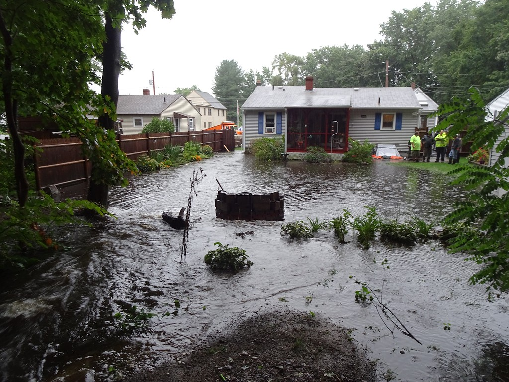 . The back of 32 Burrage Avenue, where water flooded from Monoosnock Country Club during Tuesday\'s storm. SENTINEL & ENTERPRISE / PETER JASINSKI