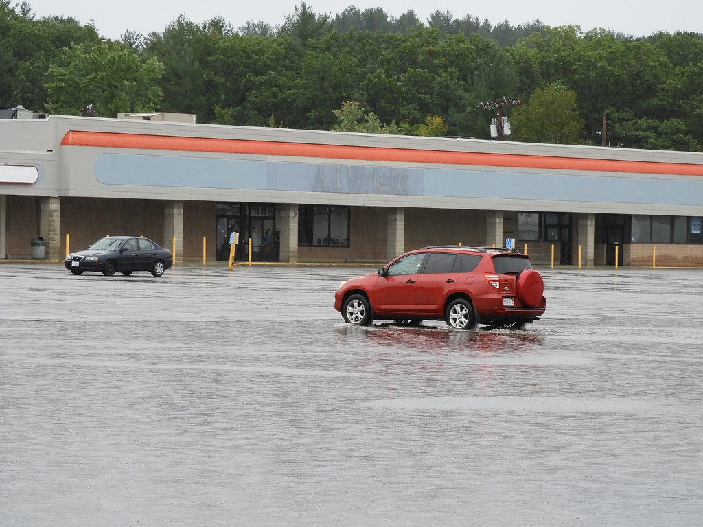. The city of Fitchburg didn\'t experience any significant flooding during the rain on Tuesday, but the parking lot  at John Fitch Plaza did have about five inches of standing water through the early afternoon. SENTINEL & ENTERPRISE / CLIFF CLARK