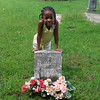 Vanessa Harris standing at the gravesite of her grandfather's brother. September 2012 in Louisburg NC.
