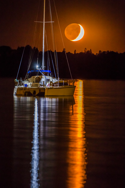 Crescent Moon Setting over Sailboat