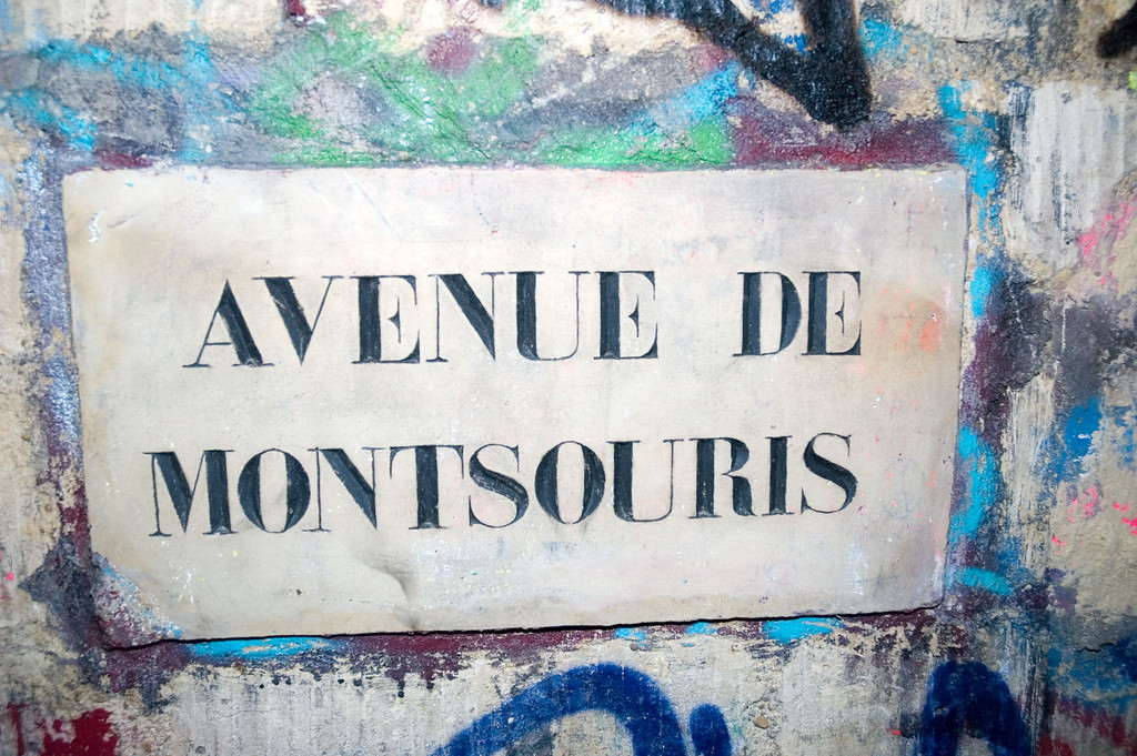 This is the name of the street above the corridor. This probably a very old inscription. This is a shame that some people managed to damage it. Fortunately, others clean them.