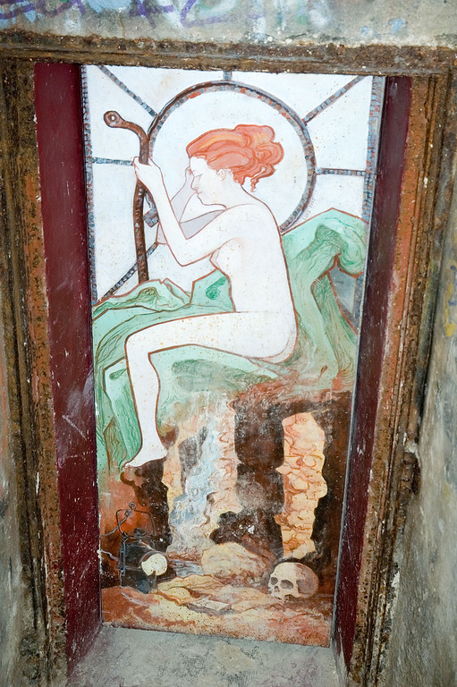 this painting is made on a door that probably leads to the cave of a building. It is of course locked. I like the painting though