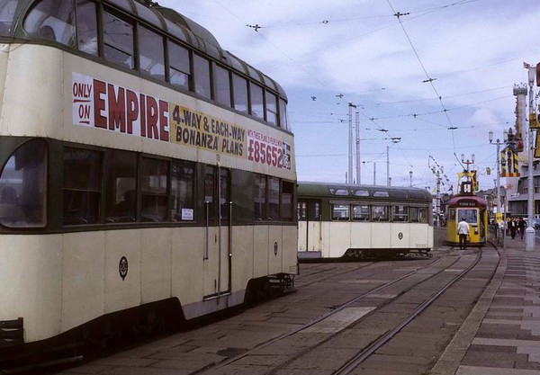 Tram jam, Blackpool, Sun 12 August 1973.  A one-man tram joins the jam at the turning loop at Pleasure Beach, with 719 at left.  Photo by Les Tindall.